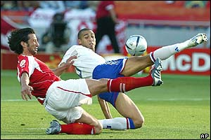 France's David Trezeguet and Switzerland's Murat Yakin