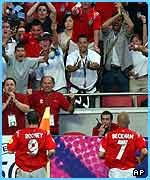 The England fans celebrate Rooney's first