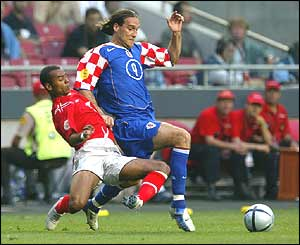 Dado Prso dribbles past England's Ashley Cole