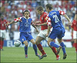 Steven Gerrard goes past Croatia's Robert Kovac