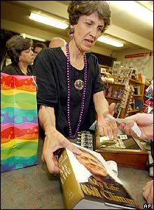 Starr Mitchell picks up her copy of the book just after midnight at Wordsworth Books in Little Rock