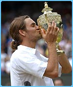 Roger Federer with Wimbledon men's singles trophy in 2003