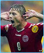 Jon Dahl Tomasson scored twice for Denmark