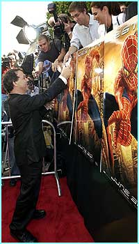 Director Sam Raimi signed a few autographs for the fans that turned up to see the stars.