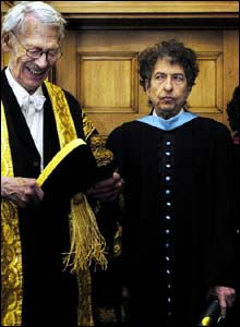 Sir Kenneth Dover, left, with Bob Dylan