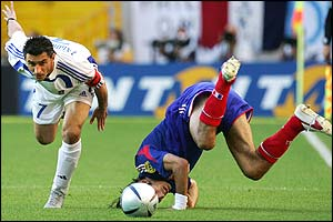 Robert Pires is fouled by Theo Zagorakis