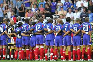 The French team stand for their national anthem