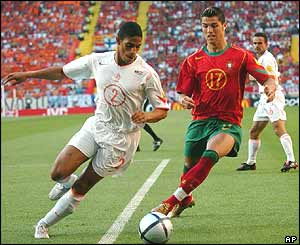 Dutch defender Michael Reiziger and Portuguese forward Cristiano Ronaldo