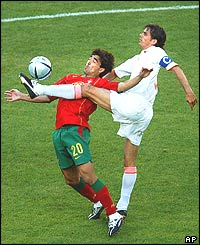 Deco of Portugal controls the ball ahead of Phillip Cocu