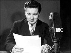 Richard Baker reading the news