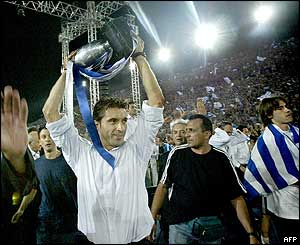 Team captain Theodoros Zagorakis lifts the trophy
