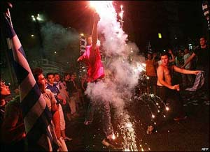 Greeks letting off fireworks at the Omonia Centre in central Athens