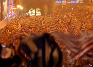 Greeks waving flags in central Athens