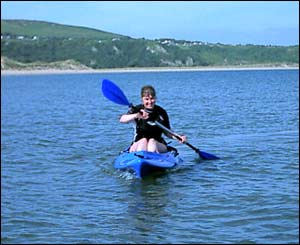 Lyn Williams of Neath took this picture of his wife Carol on her kayak at Oxwich Bay in the Gower