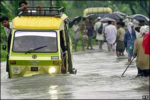 Trishaw in flooded waters in Kamalpur, Assam
