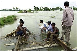 Residents besides submerged railway track in Bihar