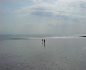 Neil Proudman's daughter Freya and son Dan on the beach at Porthcawl