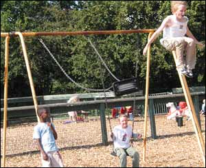 Gary Reardon leaps off the swings at Rhyd-Y-Penau Park in Llanishen (Ade Morris)