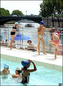 Children play in a pool at the Paris beach installation along the River Seine