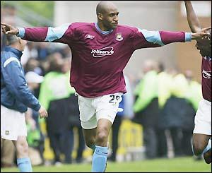Brian Deane celebrates a late equaliser for West Ham United