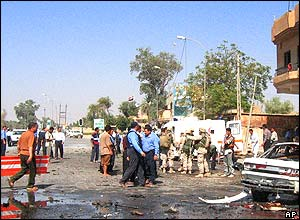 US soldiers, Iraqi police and paramedics attend to the scene of the bombing.