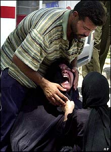 A woman who lost relatives in the blast cries