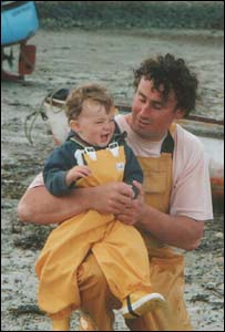 Elen Owen's 14-month-old son Owain with his father Kevin in Porthdinllaen Morfa Nefyn