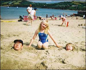 Vicky Stevens from Scotland sent this shot of her daughter Sammy burying her Dad and sister Susie in Newquay
