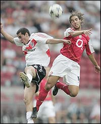 Arsenal's Matthieu Flamini jumps for a header