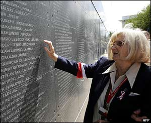An elderly veteran of the uprising looks at the wall with names of dead insurgents