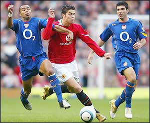 Portuguese winger Christiano Ronaldo looks to find a way through the Arsenal defence