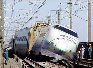 The Shinkansen train lies derailed in Nagaoka, north-western Japan