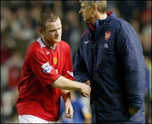 Rooney and Wenger enjoy a token handshake after the youngster's massive contribution to the final outcome of the game