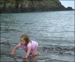 Julie Allen's daughter Tilly emerging from the sea in Pembrokeshire!