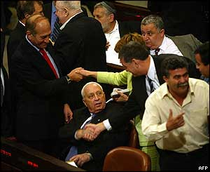 Ariel Sharon is congratulated by allies in the Israeli Knesset