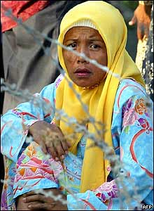 A relative of a demonstrator waits in front of a military camp in Pattani province, 26 October 2004