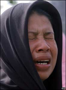 A woman bursts into tears after learning from the list that her family member is dead, 27 October 2004.