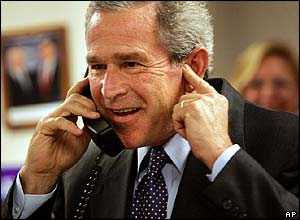 George Bush talking to Cheney on the telephone