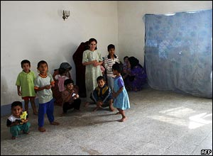The children of families who fled Falluja play in a bare room, Baghdad, Iraq