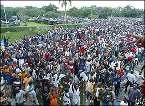Mobs gather outside Hotel Ivoire in Abidjan, protesting against the French presence in the country