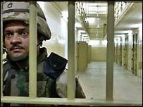 A U.S. soldier guards cells inside the prison of Abu Ghraib, outside Baghdad