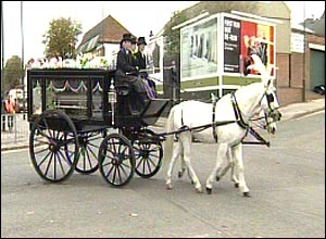 A horse-drawn carriage carried Danielle's coffin to the funeral