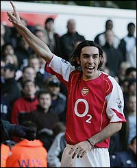 Robert Pires of Arsenal celebrates his goal
