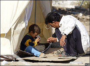 Father and son in Baghdad camp for those displaced by fighting in Falluja