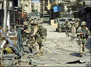 US marines walk through the destruction in Falluja