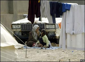 A woman and her daughter at a refugee camp set up in Baghdad
