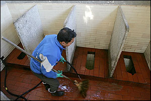 A worker gets these Beijing toilets sparkly clean ready for the World Toilet Summit starting Nov 17