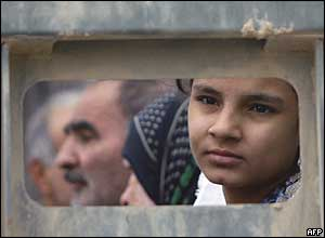 A displaced Iraqi girl waits with her family in a US marine truck to be evacuated from the city of Falluja on Thursday