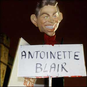 Protestester's mask of Tony Blair