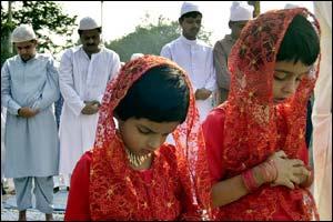 Two Muslim girls offer prayers in Calcutta, India